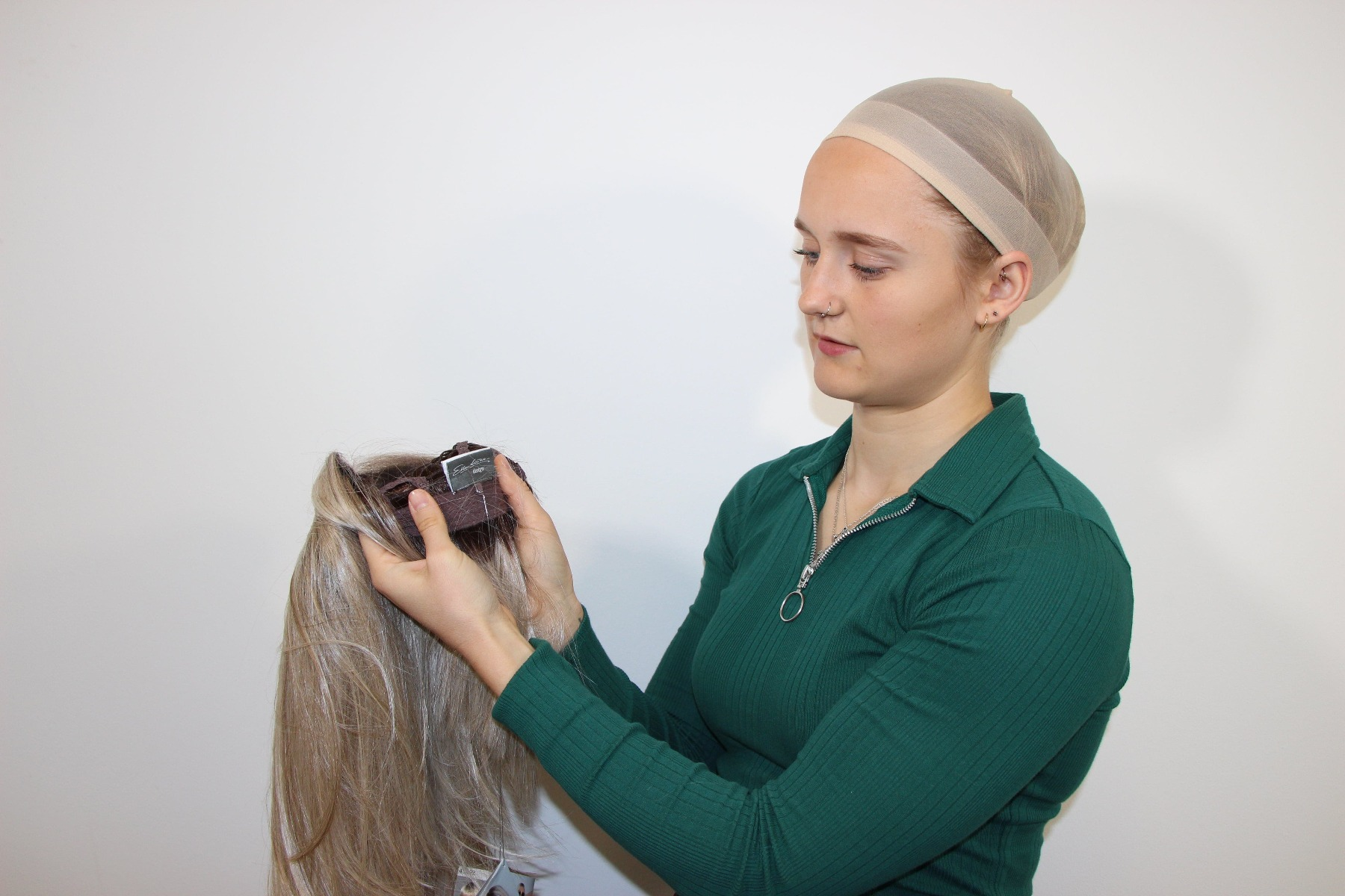 Lady finding the label on her wig